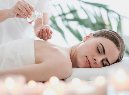 How do oils improve massage?