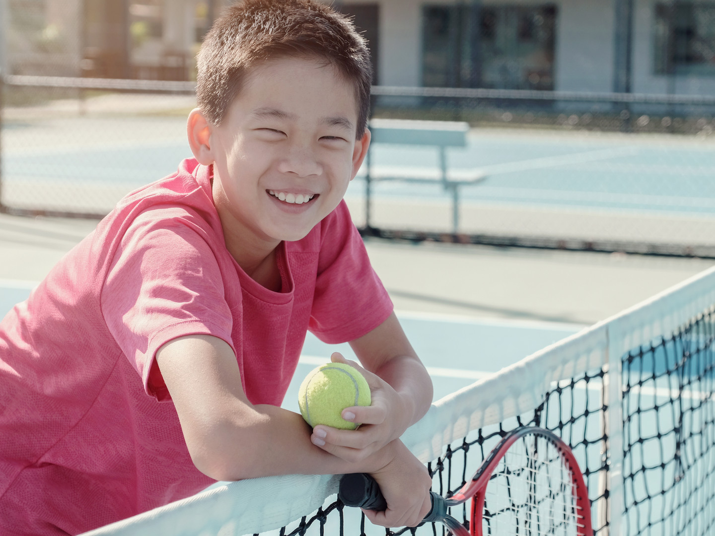 Boy on a Tennis Court