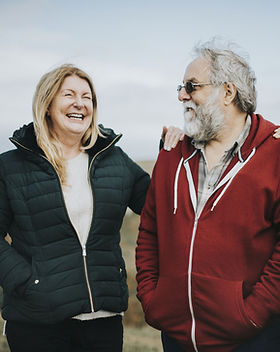 Two middle age persons laughing