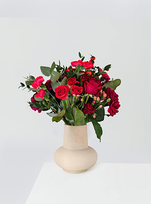 A beautiful bouquet of a dozen red roses