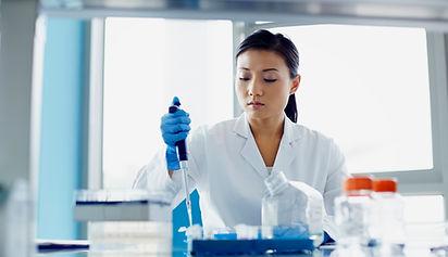 Scientist Pipetting