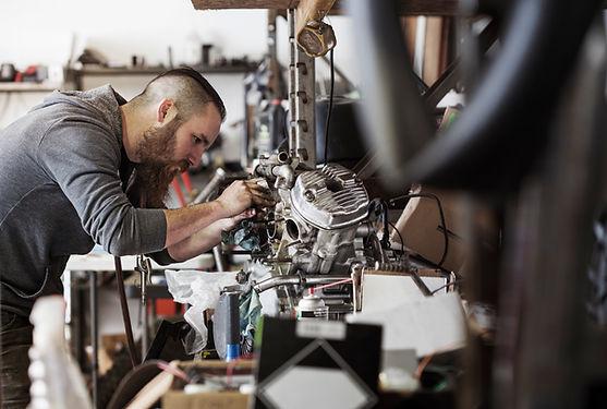 Mechanic Working on Motorcycle