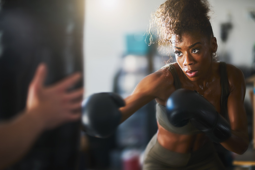 Women in boxing gloves practicing boxing