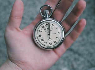 Reloj de bolsillo en la mano