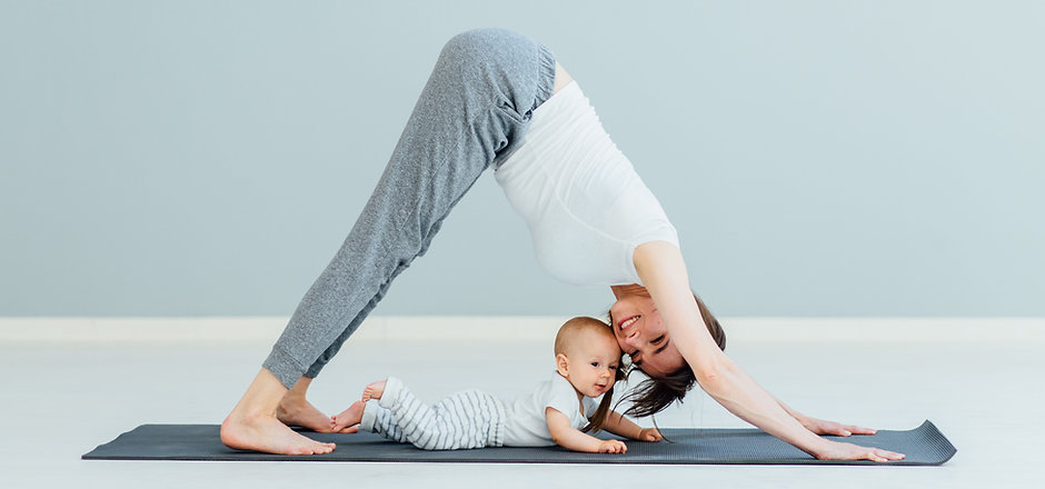 Mother Doing Yoga with Baby