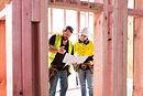 Arbeidere i byggeplassen
