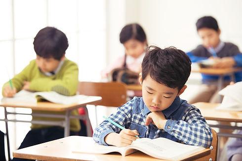 School Kids Studying In Class