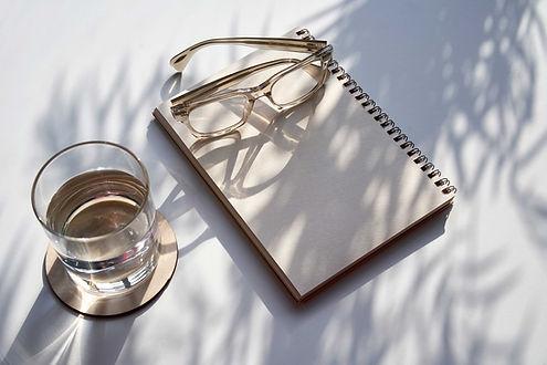 Glasses and Notebook for Website Design background