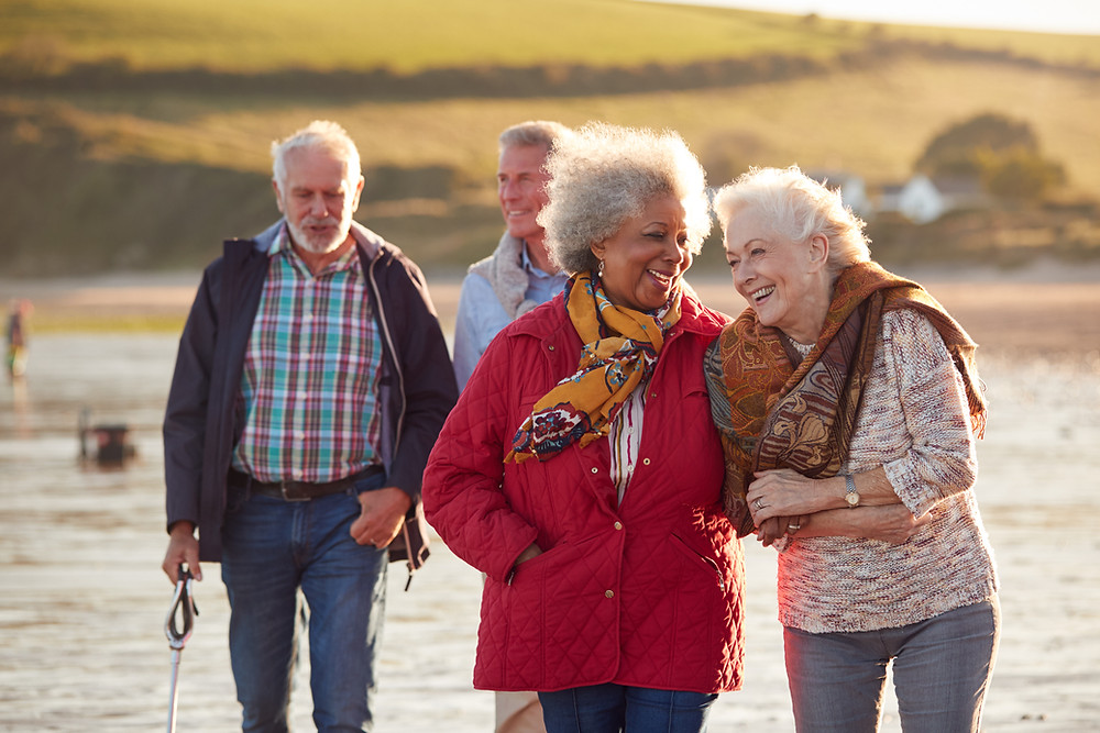 Older couples walking on the beach, fitness after 50