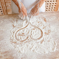 a heart shape drawn by fingers in flour on a table top
