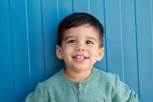 Berlin Education Station - Our Philosophy: Happy preschool boy with big brown eyes.
