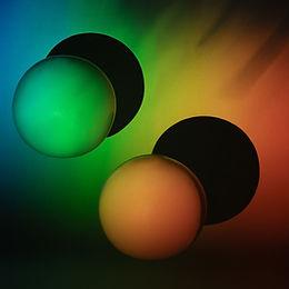 3D Balls in Rainbow Background