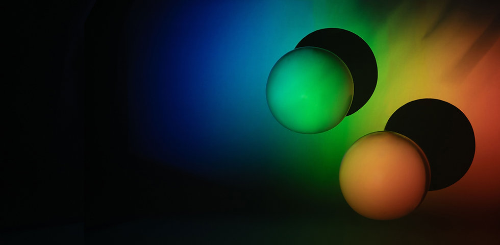 3D Balls in Rainbow Background