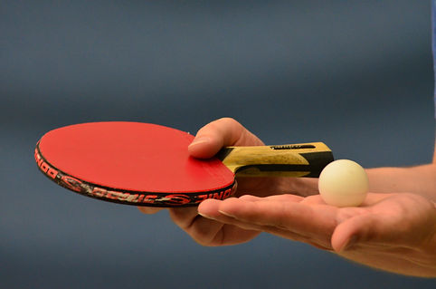 Holding Racket and Ball