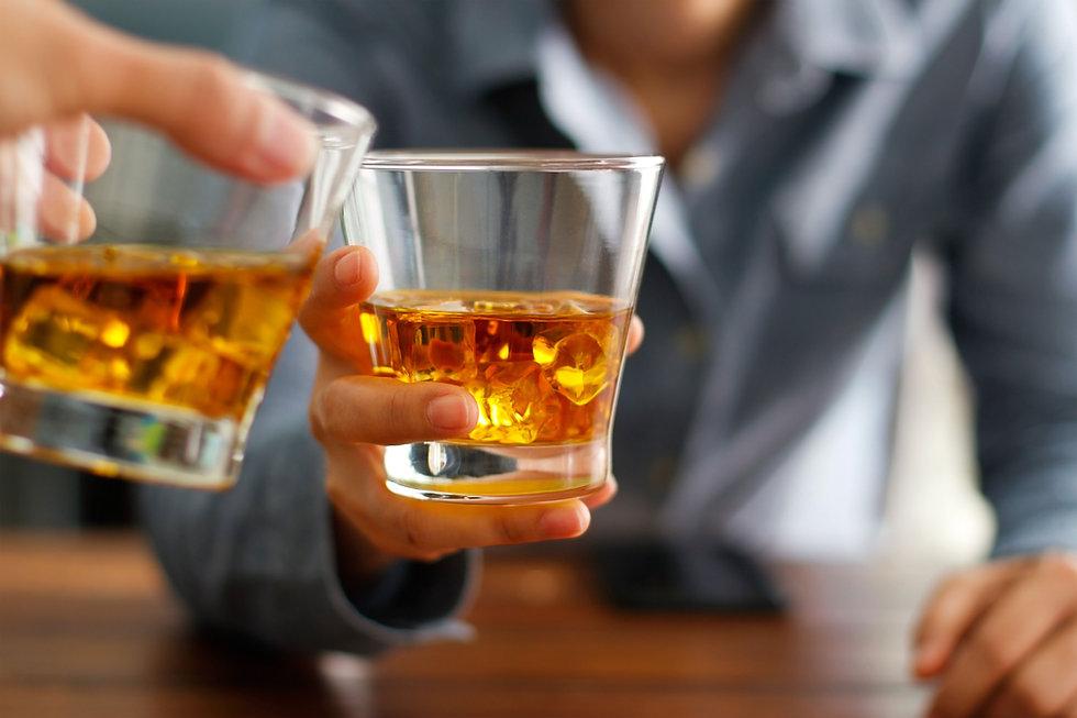 Clinking Whiskey Glasses