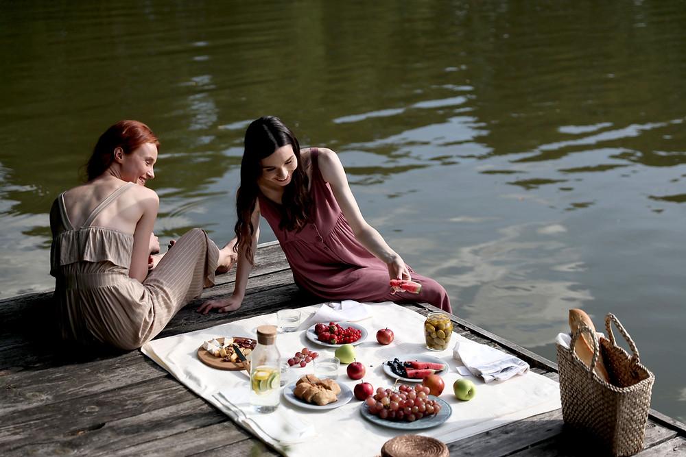 2 girls in a lake picnic
