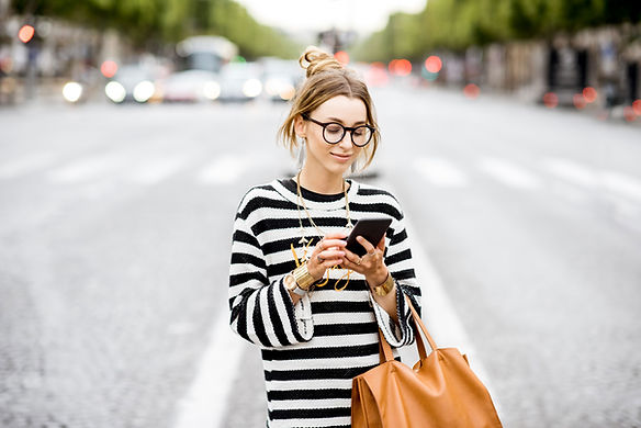 Woman on the street using Air Net Smart Talk on a mobile phone