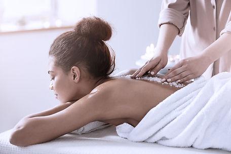 a woman getting a body scrub