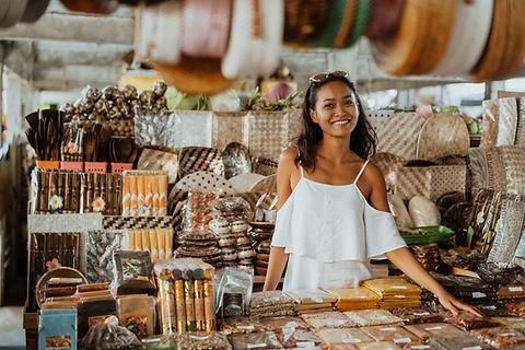 A woman standing at a souvenir store