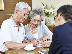 A senior couple learns about their financial options from experienced professionals