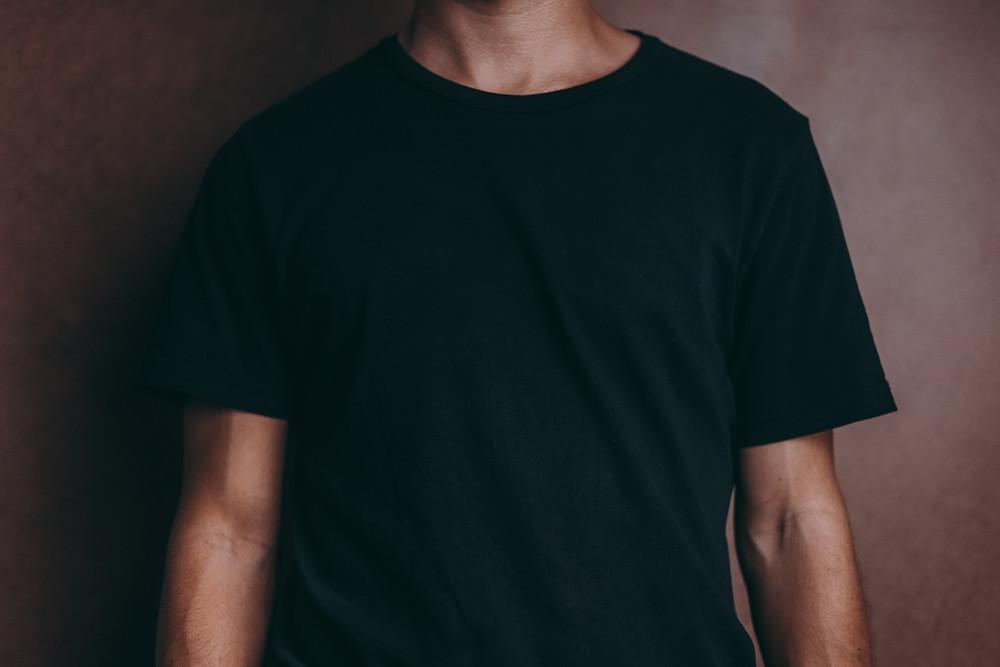 Man wearing black T-shirt