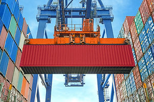 A Crane Lifting a Container
