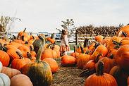 Girl in Pumpkin Farm