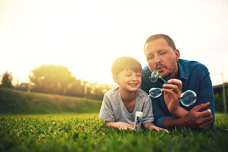Father and Son Blowing Bubbles
