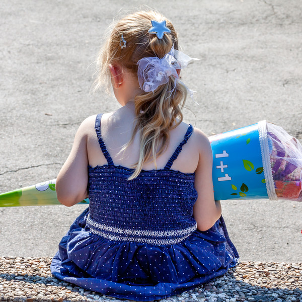 Girl with a School Cone