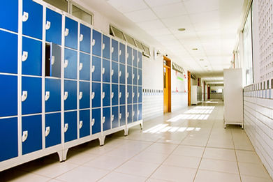 Blue Lockers In Empty Hallway