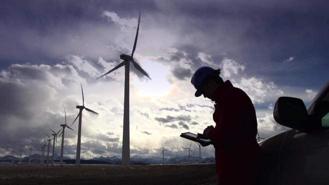 Engineer Inspecting Wind Turbines
