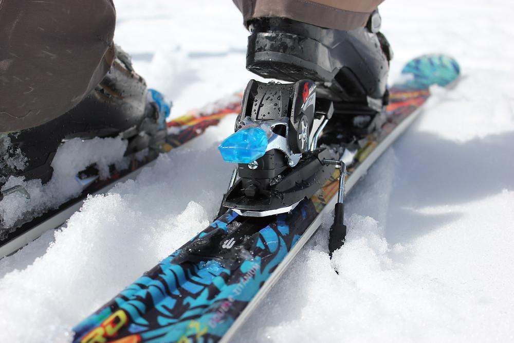Close up of ski bindings with brake
