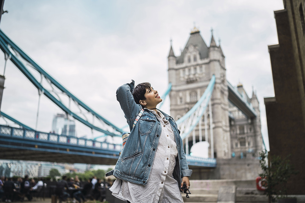 Woman in front of tower bridge