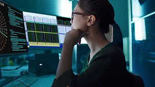 A woman looking at charts on the screen