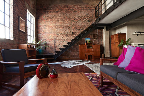 Wooden Furniture and Brick Wall