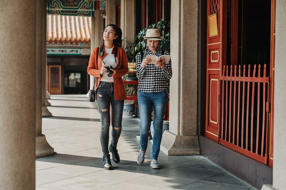 two tourist walking together
