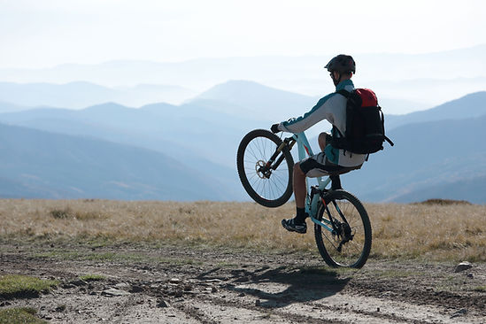 Mountain Biker Performs Wheelie