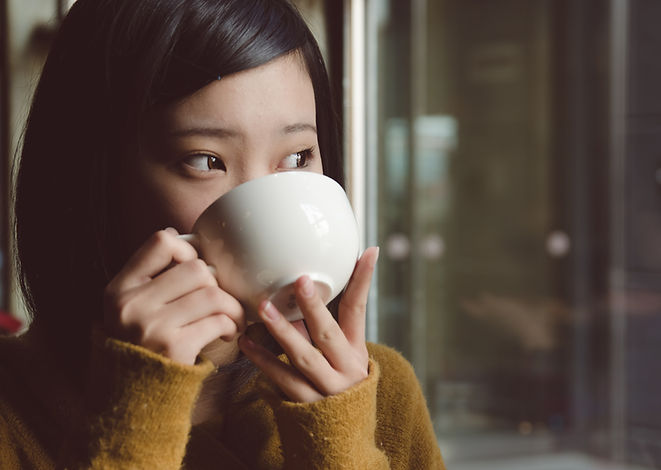 Woman peacefully sipping tea and thinking