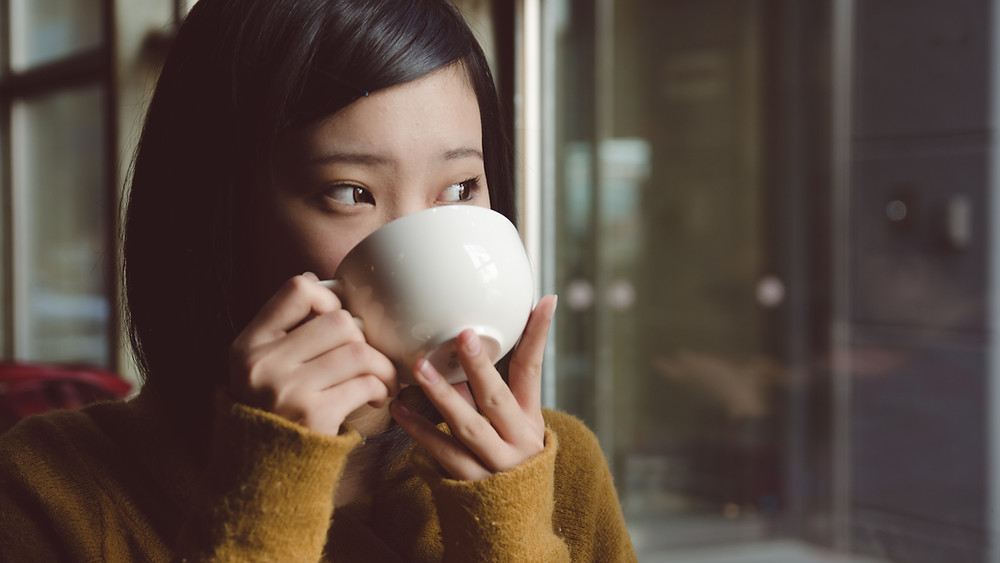 A Girl With Tea Drinking