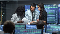 A team discussion at a trading room