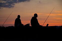 日没時の漁師