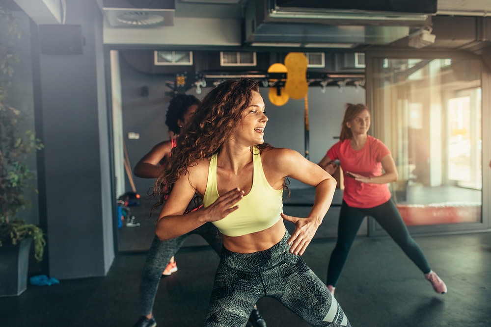 Women in dance-style exercise class