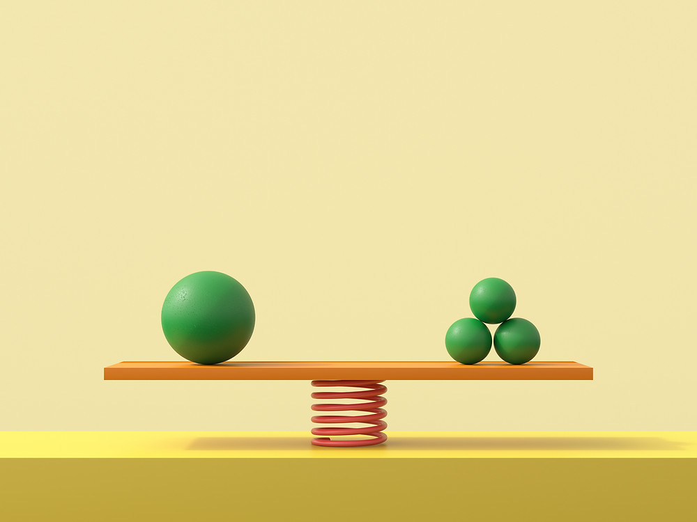 one large sphere on one side and 3 smaller spheres balanced on either side of a see-saw
