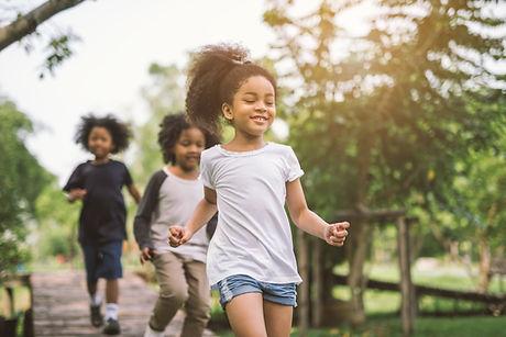 3 children running outside