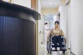 Patient en fauteuil roulant