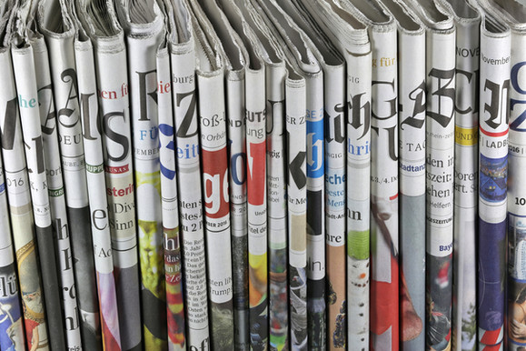 Folded Newspapers