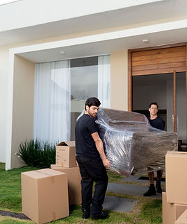 2 men moving a Couch from a Paso Robles rental home