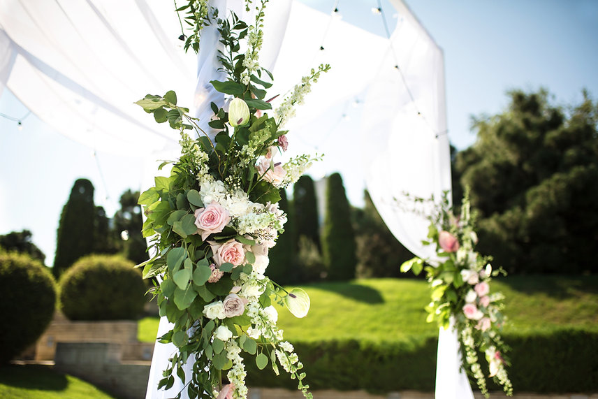 Outdoor Wedding Arch in Amherstburg, Ontario with roses and greenery