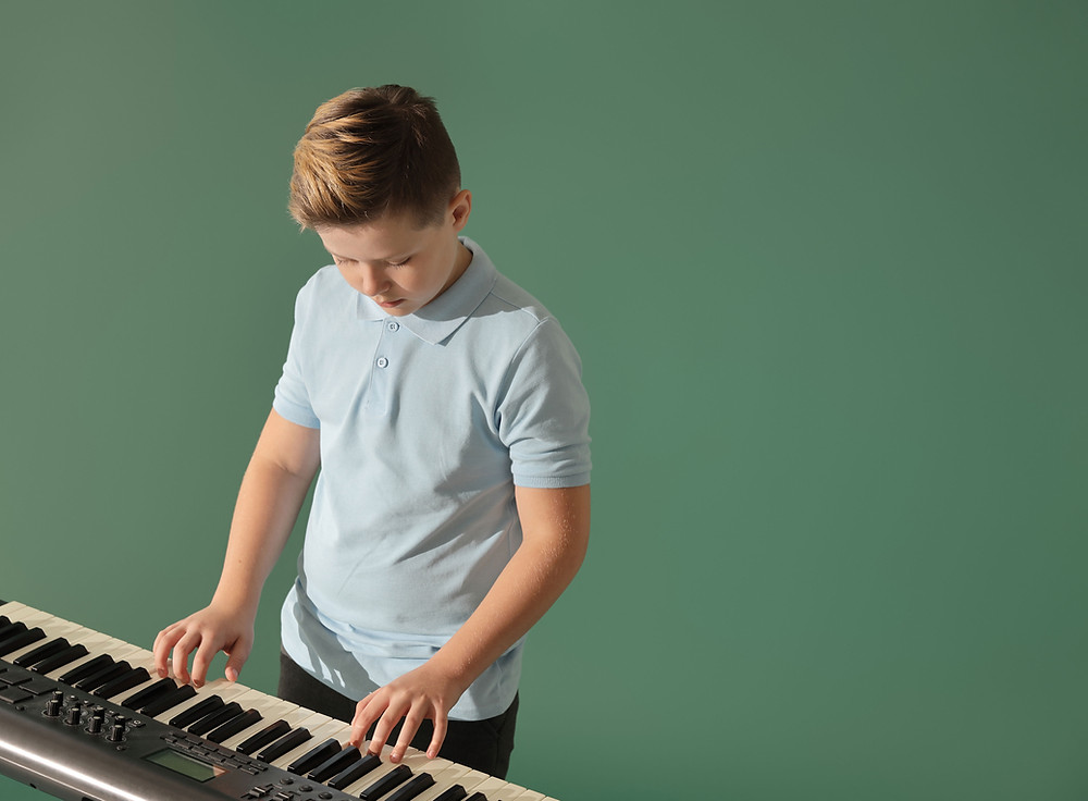 a child playing a digital piano