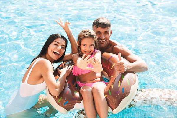 Happy family having fun in pool